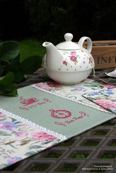 """Placemat with two mini blackwork motifs: """"I love Tea"""" and """"Tea Time"""". Designed and stiched by Valentina Sardu using fuchsia thread and 28ct antique green linen."""