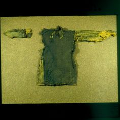 Guddal Tunic, this one is dated between 1035-1165  Check out the collar!  Several more photos can be seen of this tunic using the following searches: 030986 (full-length photo) 030987 (full-length photo) 030988 (full-length photo) 030989 (full-length photo) 030990 (full-length photo) 030991 (full-length photo) 030992 (full-length photo) 030996 (close-up of weave) 030995 (close up of edge) 030994 (close up of neck) 030993 (close up of neck) http://unimus.no/foto/imageviewer.html
