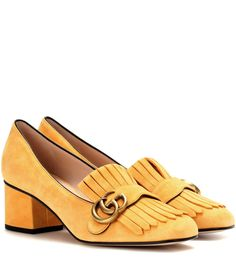 Gucci - Suede loafer pumps - We love the fringed update to these loafer-style pumps from Gucci. The dark yellow suede upper is enhanced by the house's golden GG logo and is finished with a chunky block heel. Show them off with a cropped pair of trousers. seen @ www.mytheresa.com