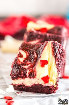 Fudgy Red Velvet White Chocolate Cheesecake Brownies are the perfect little treat for any occasion! #dessert #brownie #cheesecake  Find the recipe on www.cookwithmanali.com