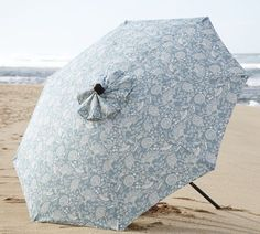 I can already picture this umbrella on the beach.....watch out fiancé....this floral umbrella like this is on the way!
