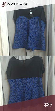 Blue cheetah peplum top Blue leopard print peplum top with sheer mesh. Sweetheart neckline. torrid Tops