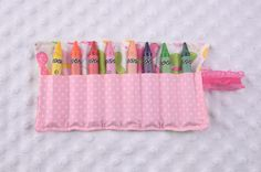 Butterfly Crayon Roll  ° 100% Cotton  ° Holds 8 crayons  ° Size: 8.5 x 5.5 inches