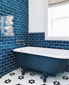Blue tile, black and white floor