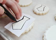 An amazingly easy way to create your own paper stencils when decorating cookies! Sugarbelle is amazing!