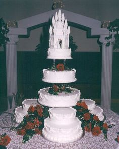 - Multi tiered, buttercream, 3 flavors of cake, silk flowers for my daughters dream wedding cake.