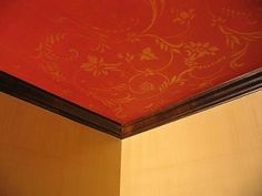 Stencil Design Over the Weave Wallpaper:  Here's the ceiling in our dining room. We did a couple of things with this project to make it look different than the other ceilings in the house. I think
