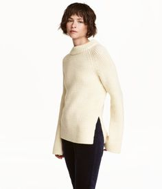 Natural white. PREMIUM QUALITY. Rib-knit sweater in soft wool with a mock turtleneck, long raglan sleeves with trumpet cuffs, and slits at sides.