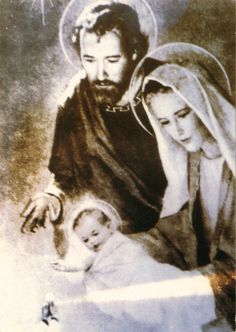 Miraculous picture of the Holy Family taken during Mass (you can see the hands of the priest holding the Host on the left corner).