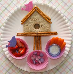• A birdhouse shaped sandwich madewith a pink bird pick and pretzel sticks  • Strawberries with a purple bird pick  • Pink & purple m's  • Carrot sticks with dip in a plastic shot glass