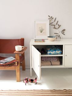 Since seeing this delectable home (and subsequently studying each room), I've developed a minor obsession with the IKEA PS Cabinet . Ikea Ps Cabinet, Ikea Cabinets, Diy Home Furniture, Ikea Furniture, Ikea Lockers, Cozy Reading Corners, Coffee Chairs, Small Entryways, Cozy Living Rooms