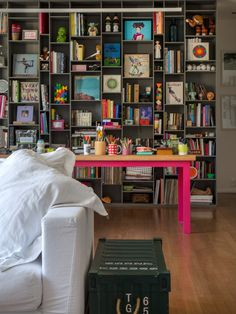 We're totally inspired by this stellar shelf styling and that incredible pop of hot pink.