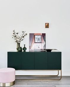 This injection of a green side board in the living room is the perfect way to add some colour to a space without making any permanent changes to the house! via @apartment_34