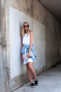 white eyelet dress, sneakers, denim jacket, printed clutch // spring outfit
