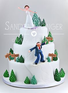Novelty Snowboarding Wedding Cake with handmade bride and groom, trees and signposts.