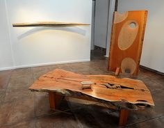 """Harold Greene made the coffee table seen in the foreground out of a carob-tree trunk. At right is Greene's sculpture """"Worm Hole,"""" made from"""