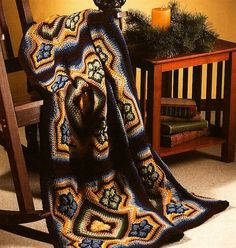 This #crochet blanket afghan pattern is made up of large stained glass squares.
