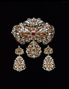 """""""Bodice Ornament (with optional pendants): Netherlands ca. 1680-1700: Rose-cut diamonds and hessonite garnets set in gold and silver""""    V"""