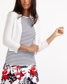 Layer in style with this Cropped Open Cardi. It's a wardrobe classic that will complete several outfits in your closet. Wear it over light blouses and pair it with capris for a comfortable look.<br /><br />Ready to wear for: a casual Friday, the weekend or a shopping spree
