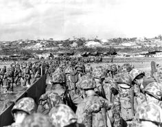 Marines wade through surf over coral reef to the Okinawa beach. APR  1 1945 The last amphibious assault in the Pacific – Okinawa - See more at: http://ww2today.com/