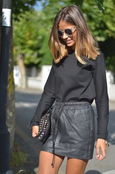 leather skirt and cute hair!