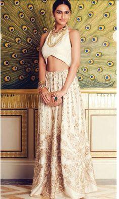 Cream and gold lehenga and blouse. Indian fashion.