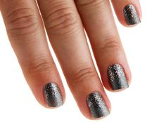 Add a sprinkle of multicolor glitter to the lower half of a gravel-colored gray nail for an evening look that dazzles.