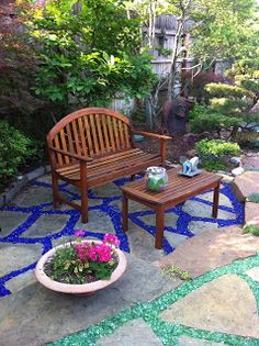 recycled glass landscaping - alternative to mulch - depending on what the rest of the yard had going on Garden Paths, Garden Art, Garden Design, Mulch Landscaping, Landscaping With Rocks, Landscaping Ideas, Landscape Glass, Landscape Design, Landscape Rocks