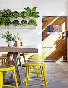 At this Manhattan juice bar and café, design firm Wanderlust tempered the masculine look of a classic butcher shop—steel meat hooks, iron butcher rails—with soft, earthy materials like white tile, bleached raw wood, and plenty of greenery. Juice taps line the bar for easy sampling, and hungry visitors can enjoy rustic vegetarian fare. thebutchersdaughter.com