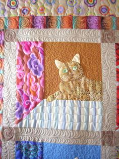 Cat in a window quilt.  Quilting by Karen Kendo, featured at Machine Quilting Resource
