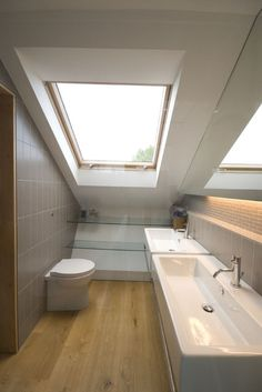 Contemporary Bathroom by Luis Trevino Architects Small bathrooms making use of slanted ceiling