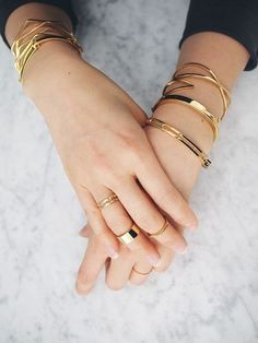 Gold bangles and gold rings.