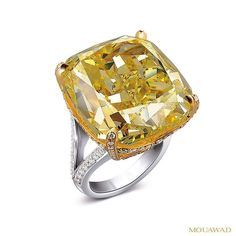 A hypnotic 53.77 carat cushion-shaped Fancy Intense yellow, internally flawless…