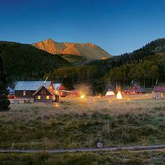 Dunton Hot Springs in Dolores, Colorado. Return to the Old West—in a low-key, not corny, way—at Dunton Hot Springs, a meticulously restored 19th-century ghost town in an alpine valley just across the mountain from Telluride, Colorado. Here, 12 cushy cabins, which sleep up to 42 guests, are clustered around natural hot springs, a dance hall, and a saloon.