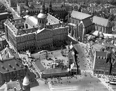 1950. Aerial shot of the Dam in Amsterdam during the 500-anniversary of the Kalverstraat. The Kalverstraat begins at the Dam and ends 750 meters down at the Munttoren. This tower was once a gate in the medieval city walls. After the walls were built, the street between the Spui and Munttoren came to be known as the Kalverstraat after the cattle market that was held there from 1486 until 1629. #amsterdam #1950 #Kalverstraat