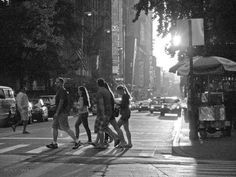 NY tourists strolling near Times Square by Ray Wu.