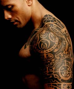 The Rock.. Great shot .. Strength .. Expressive creativity in his traditional tattoo and serenity in his look .. Not the usual phwoar look at me I have big muscles shot.