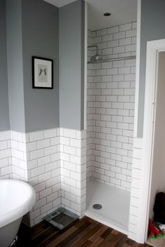 Grey bathroom with walk-in shower and subway tiles - on The Spirited Puddle Jumper Blog #bathrooms #interiors