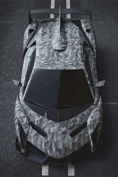 Land shark…kind of crackin' me up.  carbonandfiber:  Camo #Lamborghini Veneno