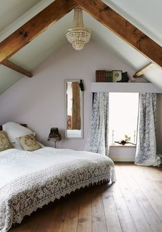 Beautiful attic bedroom in an old Northern England farmhouse looks bright and open with soft lavender walls and exposed wooden beams  (via past & present: history of curtains   http://best-home-design-collections.blogspot.com