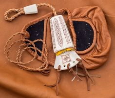 Bone needle case and leather sewing purse