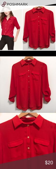"Ann Taylor Loft Red Utility Blouse -0P Chic Ann Taylor Loft Red Blouse. Wear it casual with jeans or pair it up with a black skirt!  Button Down Style. Two pockets. Sleeves can be worn rolled up and buttoned or long .  100% Polyester  📍In good condition- little wear, no rips however stain size of quarter. Front Right side of blouse.   See pic 8 Pair it with a cardigan or jacket! Non smoking home  Measurements laying flat   Pit to pit-17""  Length 24"" LOFT Tops Blouses"