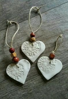 cornstarch clay ornaments with beads (cornstarch clay- baking soda, cornstarch, 1 water)Simple and pretty air dry clay heart ornaments.als Kette gestaltet MehrEmbossed air-dry clay tag or decoration -Better Than Salt Dough cup cornstarch 1 cup baking Salt Dough Christmas Decorations, Diy Christmas Ornaments, Homemade Christmas, Holiday Crafts, Ornaments Ideas, Ornaments Design, Handmade Ornaments, Kids Christmas, Ornaments Image