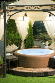 This hot tub with soft sides and extra seating is a comfortable piece for hosting a get-together in the warm water. The cloth domed gazebo above the hot tub has an elegant design, making this area more welcoming.