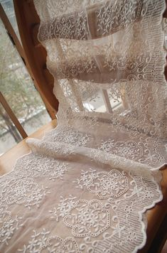 Table runners in cream lace embroidered fabric