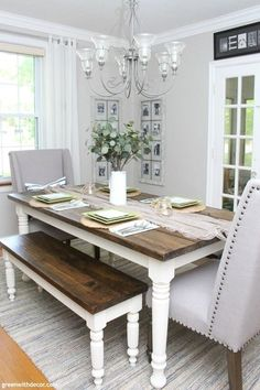 This coastal farmhouse dining room is gorgeous! I love the wood and white farmhouse table with the benches and fabric chairs. And the faux eucalyptus is a perfect everyday centerpiece! Click through to see the room full of easy decorating ideas! White Farmhouse Table, Farmhouse Dining Room Lighting, Dining Room Paint, Coastal Farmhouse, Dining Rooms, Farmhouse Style, Farmhouse Ideas, Everyday Centerpiece, Farmhouse Table Centerpieces