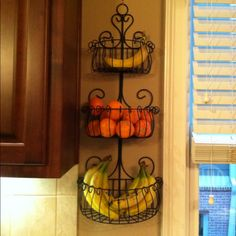 Fruit basket that attaches to the wall.