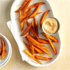Sweet Potato Wedges with Chili Mayo Recipe -Cajun spices bring the zing to roasted sweet potatoes—a side dish my family eats frequently. We dunk them in chili-spiced mayo. —Raymonde Bourgeois, Swastika, Ontario