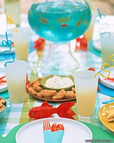 cute punch for Fishing Party ~ blue punch with gummy fish swimming around the punch.