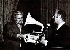Gerry Oord of Holland presents a porcelain phonograph to executive president general manager Barney Ales (Motown), 1970
